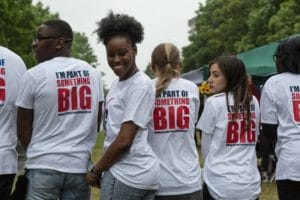 group of people with big local t shirts