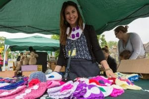 woman by knit stall