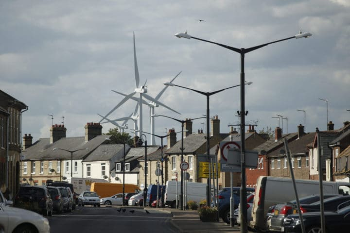 Wind turbines behind residential street